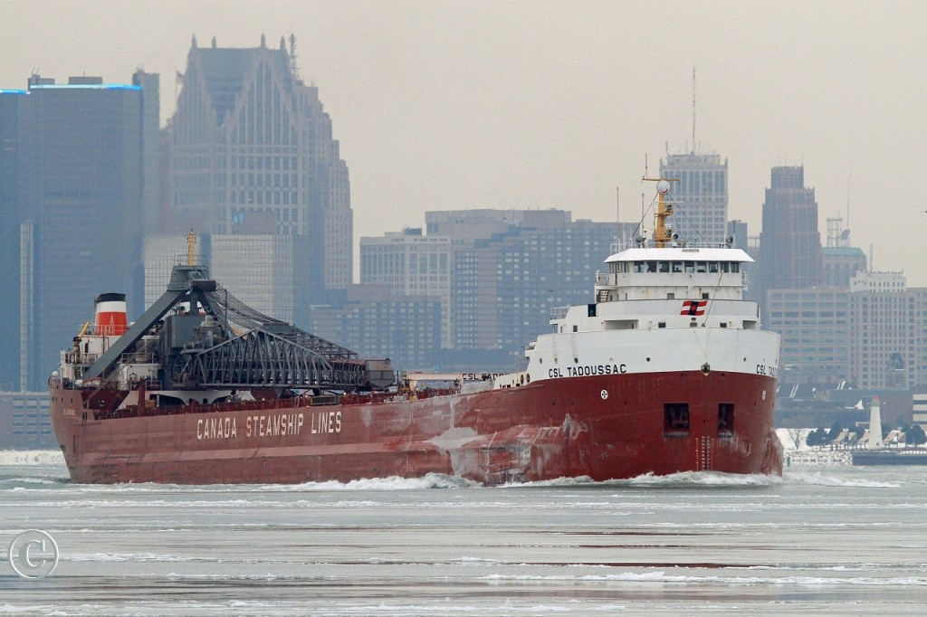 After fueling at Sterling Marine Fuels in Windsor, the CSL Tadoussac, under full power, charges upbound on the Detroit River destined for Superior Wisconsin.