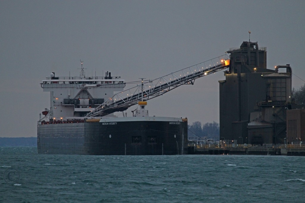 The American Integrity off-loads coal at the St. Clair Edison Power Plant at Recor Point on the St. Clair River.