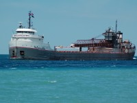 Michipicoten sails loaded downbound on a summers afternoon at Sarnia, Ontario.