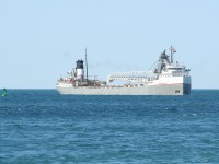 The Mississagi rounds the marker buoy on Lake Huron to enter the channel at the mouth of the St. Clair river.
