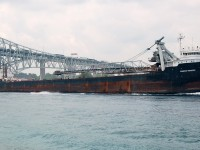"Canadian Transfer of the then Upper Lakes Shipping company sails up bound under the bluewater bridge at Sarnia. With the sale of the Upper Lakes fleet to Algoma shots like this are no longer possible. Today the ""transfer"" sails as Algoma Transfer."