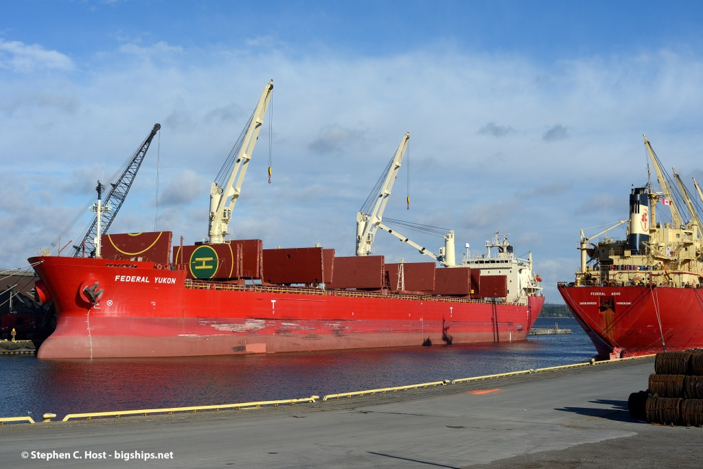Two Japanese built FedNav ships - Yukon and Agno are docked at Hamilton, Ontario - in pretty fall lighting.