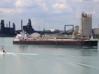 Sam Laud is upbound the Detroit River on a nice summer day.