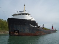 Having just gone under the Allanburg bridge. Canadian Miner is downbound in the Welland Canal for Lock 7.