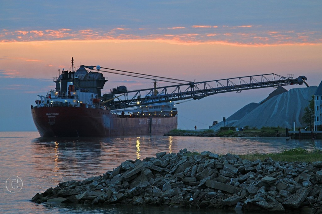 Working through the night, the Frontenac discharges stone at Southwest Sales in east Windsor as dawn approaches. The Frontenac was built by Davie Shipbuilding in Lauzon, QC in 1968. She was converted to a self-unloader at Collingwood Shipyards in 1973.