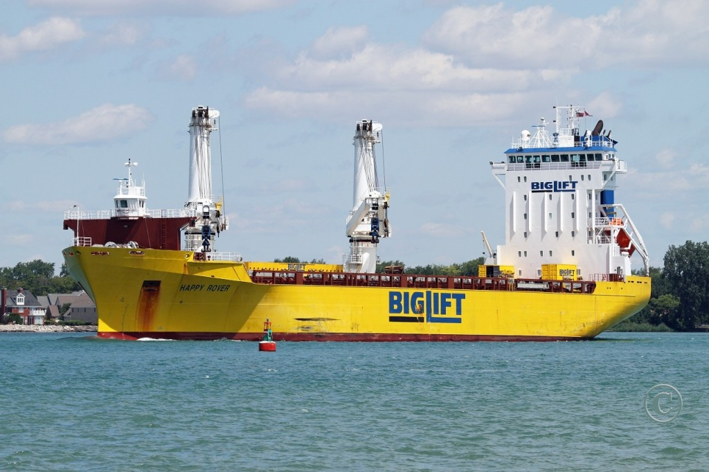 The general cargo carrier Happy Rover is downbound on the Detroit River at Windsor.