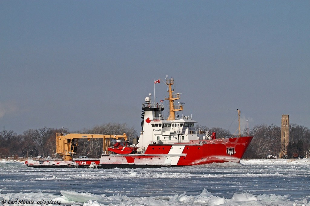 The CCGS Samuel Risley, upbound on the Detroit River in heavy ice, leads a convoy of ships (Saginaw, Algomarine, CSL Tadoussac) to lower Lake Huron.