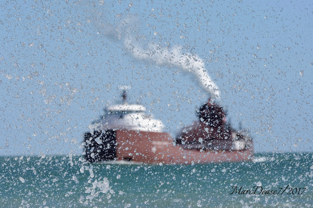 Some strong north winds on Lake Huron last week brought some serious waves crashing ashore. Here I caught the splash of the waves with the Hon. James L. Oberstar making the turn down bound at buoys 1 & 2.