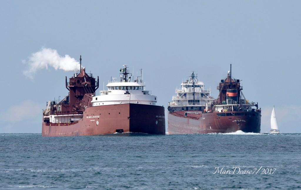Hon. James L. Oberstar meets fleet mate Kaye E. Barker above buoys 1 & 2 in lower Lake Huron.